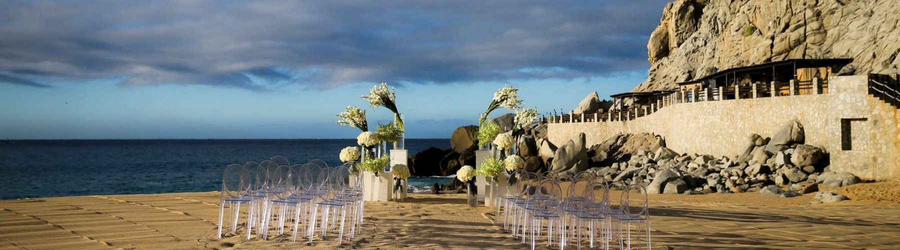A wedding reception on the beach with floral arrangements at The Resort at Pedregal