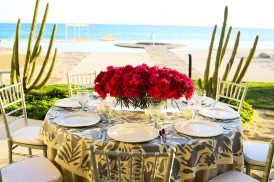 A plated wedding reception dinner on the beach in Cabo San Lucas