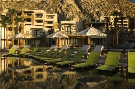 Pool with green chairs at The Resort at Pedregal