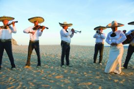 A traditional Mexican wedding ceremony with a mariachi band on the beach in Cabo San Lucas