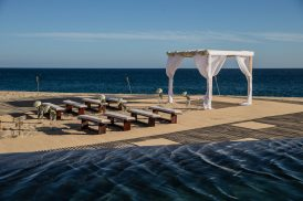 A wedding ceremony on the beach at The Resort at Pedregal