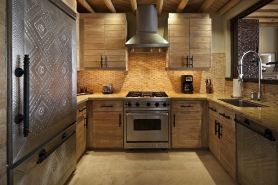 Fully equipped, rustic kitchen in the 3-Bedroom Deluxe Ocean View Suite accommodation at The Resort at Pedregal